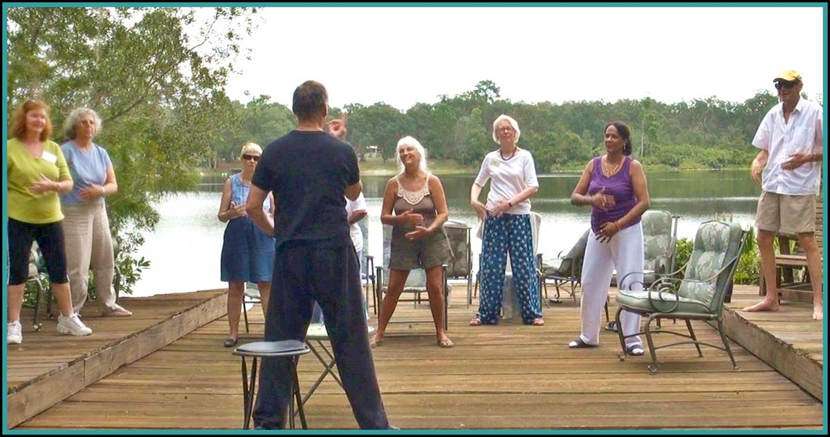 Qi Gong on the dock at Dancing Peacock Paradise